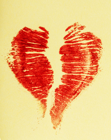Imprint of female lips red lipstick in the form of heart on a napkin photo