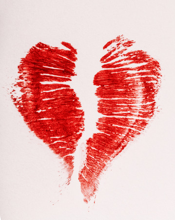 Imprint of female lips red lipstick in the form of heart on a napkin Stock Photo