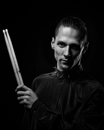 Young drummer man portrait artist of rock music