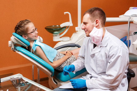 Child on inspection the dentist in the dental clinic photo