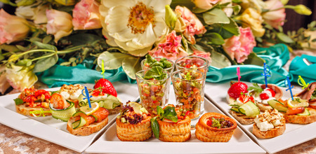 Restaurant food in the form of snacks, sandwiches and canapes closeup shot Stock Photo