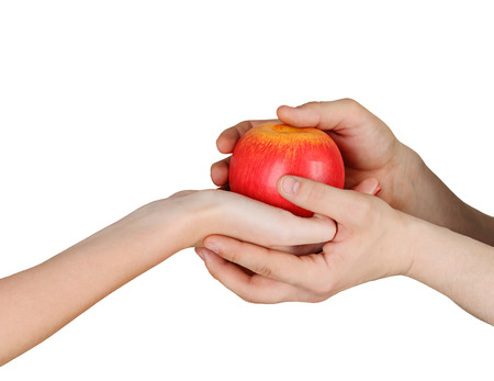 Male and female hands holding an apple isolated on white background