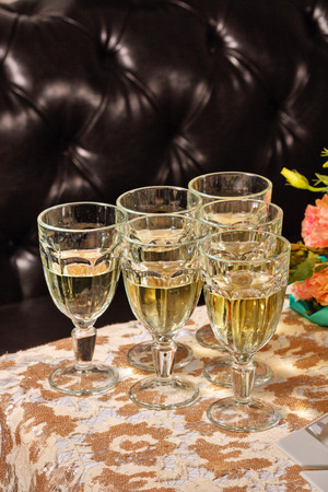 White wine in a wine glasses stands on a buffet table closeup shot Stock Photo