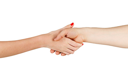 Man and woman shaking hands isolated on white background. Unrecognizable people photo