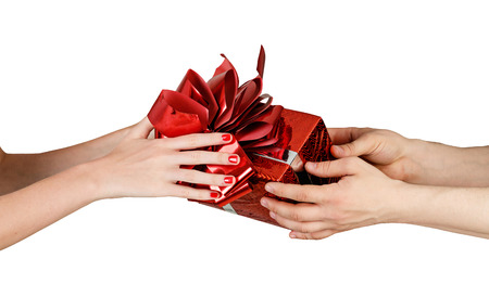Male hands give a gift to female hands isolated on white background close up shot photo