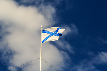 andrews: St Andrews flag on the flagpole waving in the wind against a blue sky
