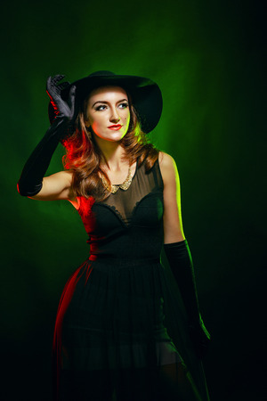 beldam: Portrait of a young attractive girl in a witch costume for Halloween Stock Photo