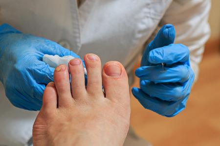 Process pedicure close up in a fashionable spa salon, unrecognizable people