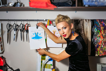 Fashion designer working with dummy and cloth Standard-Bild