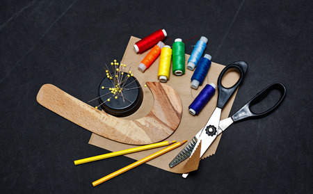 craft material tinker: Tools trendy designer clothing thread, paper, scissors and needles Stock Photo