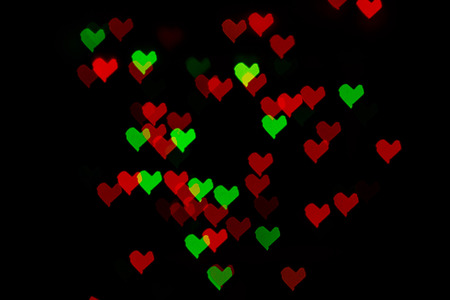 Multicolored abstract background of lights in the form of the heart is not in focus photo