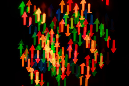 stylishly: Multicolored abstract background of lights in the form of an arrow is not in focus