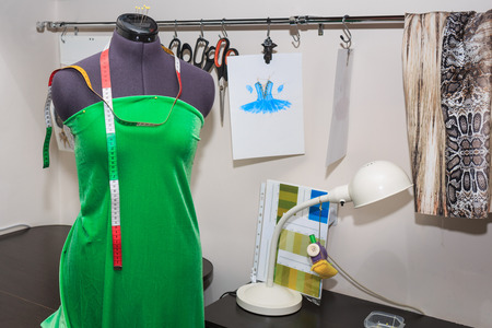 be dressed in: Mannequin dressed in gown to be in the studio fashion designer clothing