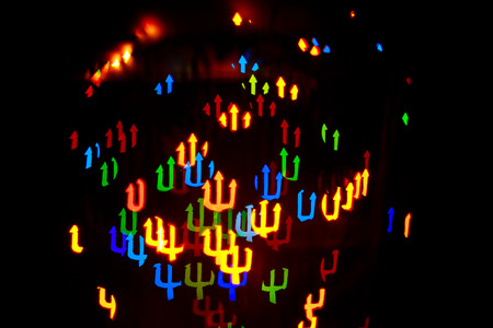 stylishly: Multicolored abstract background of lights in the form of a trident is not in focus