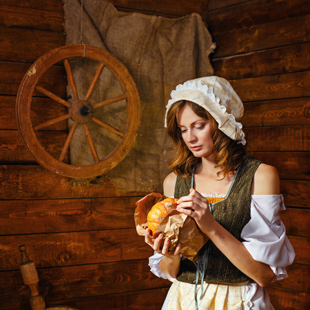 Peasant Woman cook a festive meal to the day of harvest. Retro stylized image.