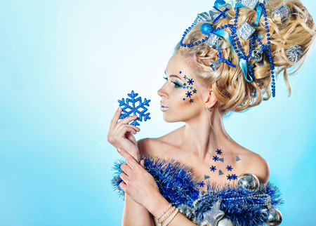 Young attractive blonde girl with creative hairdo christmas close-up portrait