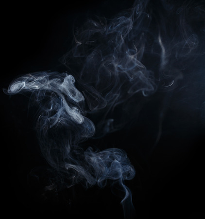 Abstract smoke moves on a black background Standard-Bild