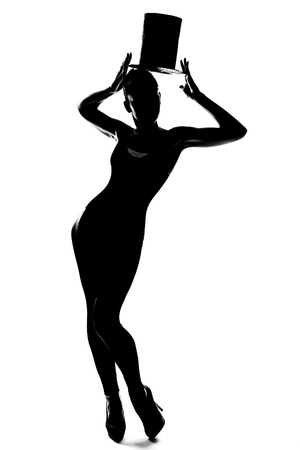 Silhouette fashion slim girl dancing with hat cylinder