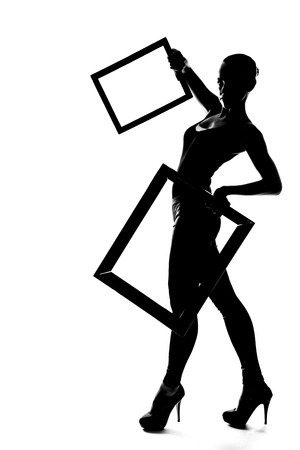 Silhouette fashion slim girl dancing in high heels with frame