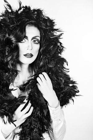 feather boa: Portrait of girl with makeup and feather boa shot in high key