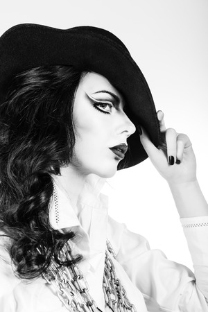 Portrait of girl with makeup and hat shot in high key photo
