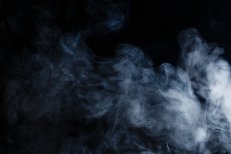 smoke effect: Abstract smoke moves on a black background Stock Photo