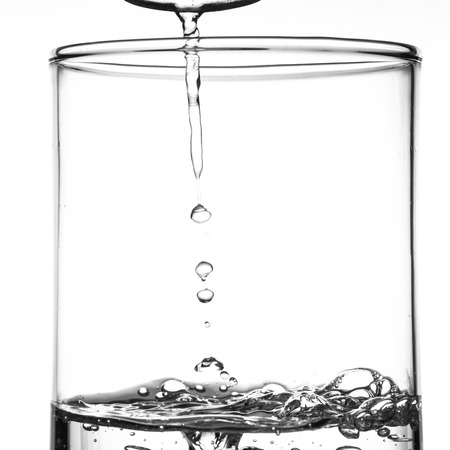 air bubbles: Clear water with air bubbles in the glass Stock Photo