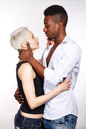Multiracial cute couple hugging each other passionately. Stock Photo