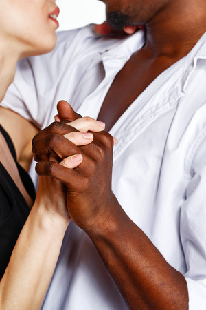 Multiracial cute couple hugging each other passionately. photo