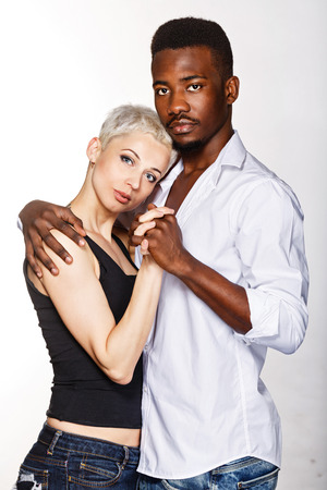 passionately: Multiracial cute couple hugging each other passionately. Stock Photo