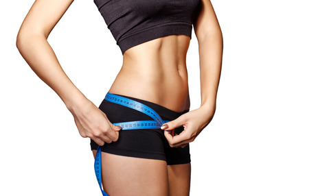 Woman measuring perfect shape of beautiful hips. Healthy lifestyles concept. Sports lifestyle.