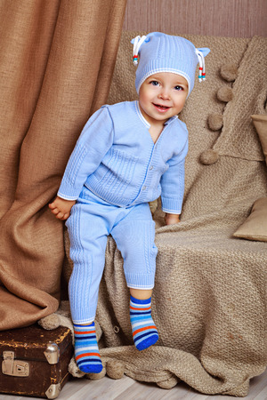 shyness: Little cute baby in pajamas, shot in home interior