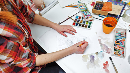 brush drawing: The artist paints a picture to pencil sketches. Art background