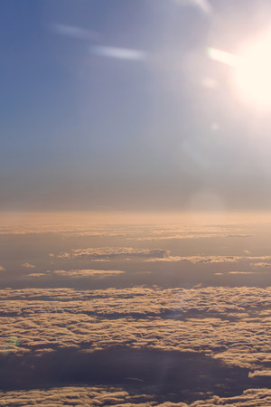 sky natural: View of clouds from the window of a jet aircraft. Flying above the clouds. Clouds at dawn. Concept travel.