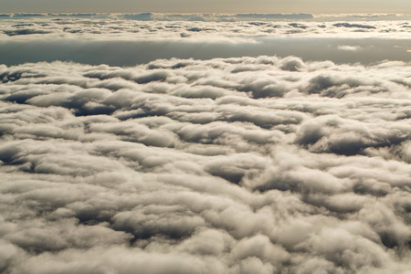 Airplane above the clouds. View of the clouds from the window. Concept travel. photo
