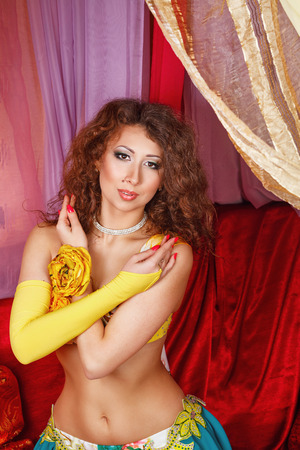 harem: Oriental beauty sitting in a tent. The concept of the Arab harem.