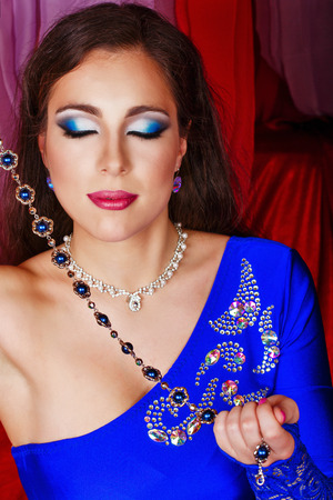 harem: Young oriental beauty holding jewelry. The concept of the Arab harem.