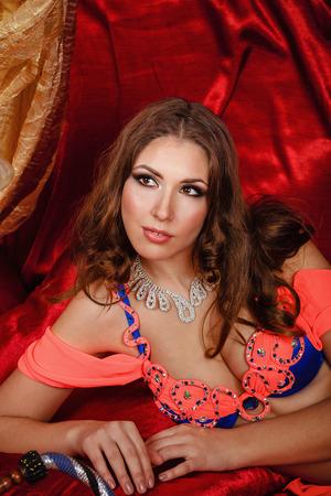 harem: Sexy oriental beauty close-up portrait. The concept of the Arab harem. Stock Photo
