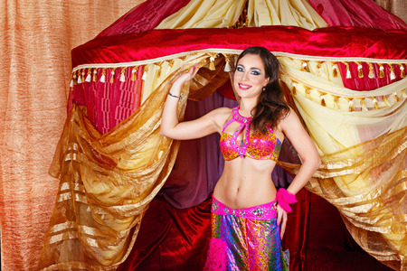 arabian harem: Sexy oriental beauty dancing belly dance in front of the tent. The concept of the Arab harem.