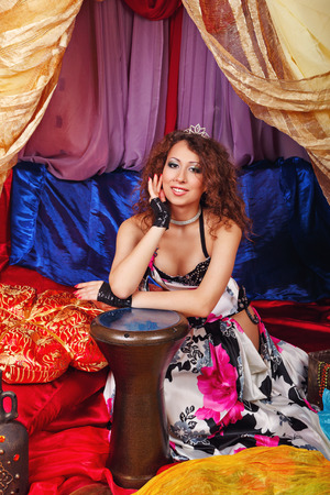 harem: Sexy oriental beauty and tabla. The concept of the Arab harem.