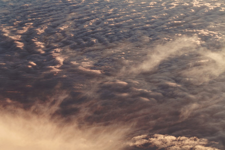Sunset. Clouds from the altitude of the aircraft. Aerial view. Concept travel. photo
