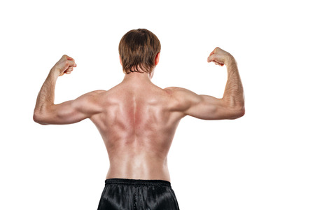 enforcer: Man shows the muscles of the back. Isolated on white background. The concept of a strong man and a healthy lifestyle. Stock Photo