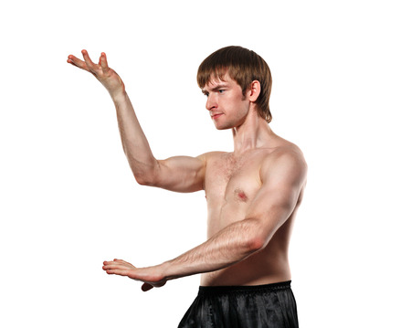 enforcer: The man trains kata kung fu. Isolated on white background. Healthy lifestyle concept.
