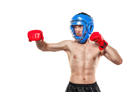 enforcer: Male fighter in sports helmet and gloves. Isolated on white background. The concept of martial arts.