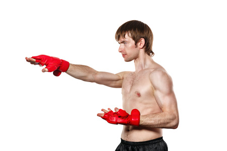 enforcer: Male fighter kung fu strike directly. Isolated on white background. The concept of martial arts. Stock Photo