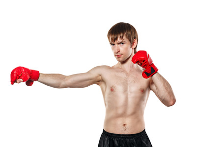 enforcer: Male fighter mixed martial strike directly. Isolated on white background. The concept of martial arts. Stock Photo