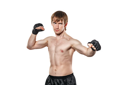 enforcer: Male fighter mixed martial ready to fight. Isolated on white background. The concept of protection from attack.