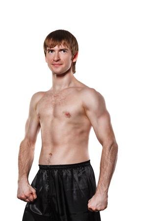 enforcer: Man kata trains kickboxing. Isolated on white background. The concept of martial arts.