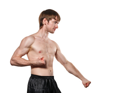 enforcer: The man trains kata taekwondo. Isolated on white background. The concept of masculine strength and a healthy lifestyle.