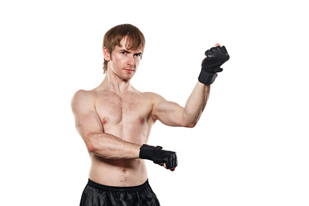 enforcer: Male fighter in mixed martial fighting gloves. Isolated on white background. Healthy lifestyle concept.